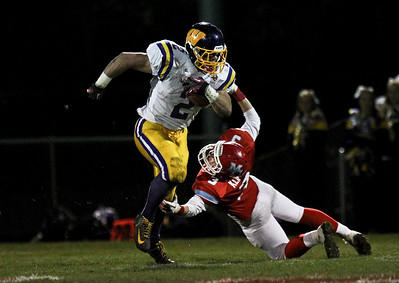 Josh Peckler - Jpeckler@shawmedia.com Marian Central's Tom Klinger (3) attempts to tackle Wauconda's David Starkey during the second quarter against Wauconda at Marian Central High School Friday, October 26, 2012. Marian Central defeated Wauconda 42-10 in a IHSA 5A first round playoff game.