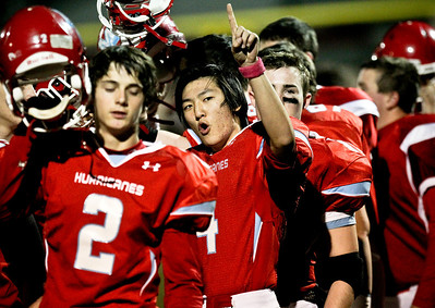 Josh Peckler - Jpeckler@shawmedia.com Marian Central's Charles Shin holds up his finger after the national anthem was played before a game against Wauconda at Marian Central High School Friday, October 26, 2012. Marian Central defeated Wauconda 42-10 in a IHSA 5A first round playoff game.