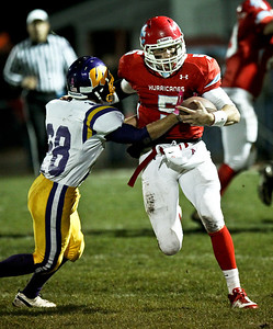 Josh Peckler - Jpeckler@shawmedia.com Marian Central's Chris Streveler (5) breaks away from Wauconda's Bruce Pearl during the second quarter at Marian Central High School Friday, October 26, 2012. Marian Central defeated Wauconda 42-10 in a IHSA 5A first round playoff game.