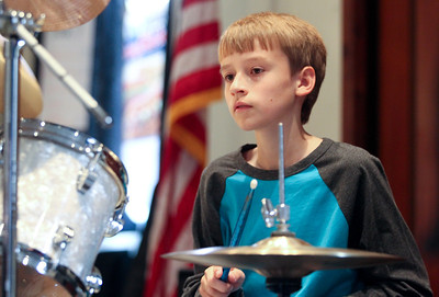 """Mike Greene - mgreene@shawmedia.com Nathan Tappen, 13 of Crystal Lake, plays the drums while performing with Classified Information during the annual Music Makers MusicThon Sunday, October 7, 2012 at The Pointe in Crystal Lake. The event featured teachers and students from Music Makers performing for 10 hours straight as well as raffles, a """"Spooky Room"""" and vendors to raise money for kids in the community who have lost needed music lessons due to financial hardships."""