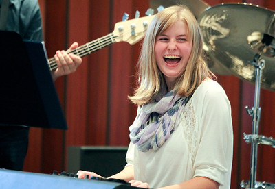 """Mike Greene - mgreene@shawmedia.com Liz Bregenzer, 15 of Crystal Lake, laughs while playing the keyboard with Classified Information during the annual Music Makers MusicThon Sunday, October 7, 2012 at The Pointe in Crystal Lake. The event featured teachers and students from Music Makers performing for 10 hours straight as well as raffles, a """"Spooky Room"""" and vendors to raise money for kids in the community who have lost needed music lessons due to financial hardships."""