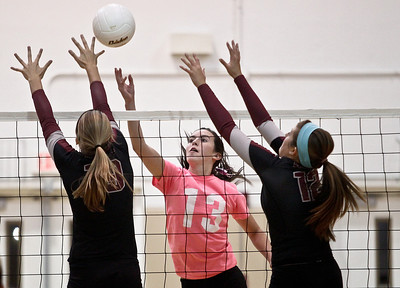 Josh Peckler - Jpeckler@shawmedia.com Jacobs' Katie Mahoney (13) attempts to tips the ball past Prairie Ridge's Ali Witt (left) and Mackenzi Humm during the first set at Jacobs High School Thursday, October 11, 2012. Prairie Ridge went on to win the match 2-1.