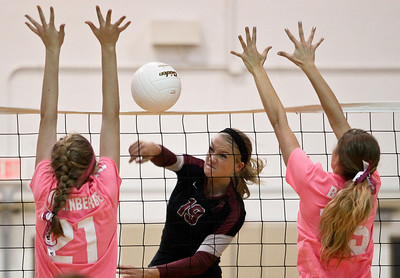 Josh Peckler - Jpeckler@shawmedia.com Prairie Ridge's Ali Witt (19) attempts to hit the ball past Jacobs' Bridget Wallenberger (21) and Jenna Bilgrien during the second set at Jacobs High School Thursday, October 11, 2012. Prairie Ridge went on to win the match 2-1.
