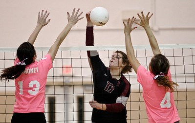 Josh Peckler - Jpeckler@shawmedia.com Prairie Ridge's Maddie Drain hits the ball past Jacobs blockers Katie Mahoney (13) and Alyssia Dugo during the second set at Jacobs High School Thursday, October 11, 2012. Prairie Ridge went on to win the match 2-1.