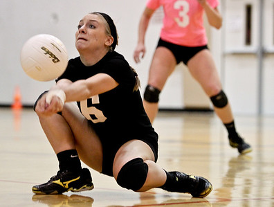 Josh Peckler - Jpeckler@shawmedia.com Jacobs' libero Kassie Kasper gets low to dig up a ball during the second set at Jacobs High School Thursday, October 11, 2012. Prairie Ridge went on to win the match 2-1.
