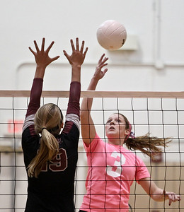 Josh Peckler - Jpeckler@shawmedia.com Jacobs' Alyssa Ehrhardt (3) attempts to tip the ball over Prairie Ridge's Ali Witt during the third set at Jacobs High School Thursday, October 11, 2012. Prairie Ridge went on to win the match 2-1.