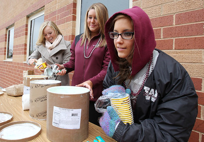 Mike Greene - mgreene@shawmedia.com Junior Ryan Sennholtz (right), 17, takes an ice cream order during a homecoming block party Friday, October 5, 2012 at Prairie Ridge High School in Crystal Lake. Homecoming festivities capped off with a home football game against Jacobs Friday night. Jacobs defeated the Wolves 34-16.
