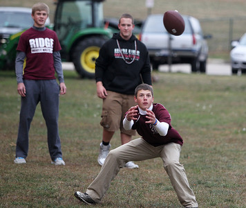 Mike Greene - mgreene@shawmedia.com Sophomore Matt Kenning, 15, prepares to catch a football while playing catch during a homecoming block party Friday, October 5, 2012 at Prairie Ridge High School in Crystal Lake. Homecoming festivities capped off with a home football game against Jacobs Friday night. Jacobs defeated the Wolves 34-16.