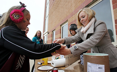 Mike Greene - mgreene@shawmedia.com Junior Wolves Cheerleader Mackenzie Schmidt, 6, gets free ice cream from Claire Bowman, 16, during a homecoming block party Friday, October 5, 2012 at Prairie Ridge High School in Crystal Lake. Homecoming festivities capped off with a home football game against Jacobs Friday night. Jacobs defeated the Wolves 34-16.