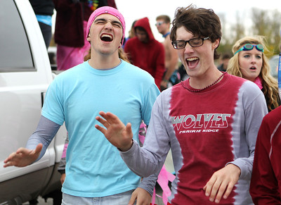 Mike Greene - mgreene@shawmedia.com Seniors Sean Lochmeyer, 17, and Steven Mondloch, 17, sing with members of the Madrigals while returning to campus after a parade during homecoming celebrations Friday, October 5, 2012 at Prairie Ridge High School in Crystal Lake. Homecoming festivities capped off with a home football game against Jacobs Friday night. Jacobs defeated the Wolves 34-16.