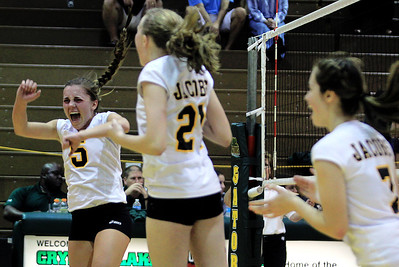 Sarah Nader - snader@shawmedia.com Jacobs' Maris Smith (left) celebrates a point during Tuesday's Class 4A Crystal Lake South Regional volleyball tournament against Crystal Lake South on October 20, 2012 in Crystal Lake.