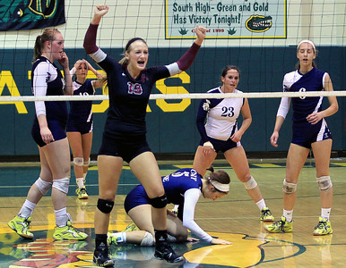 Sarah Nader - snader@shawmedia.com Prairie Ridge's Ali Witt (center) celebrates the teams win during Tuesday's Class 4A Crystal Lake South Regional volleyball tournament against Cary-Grove on October 20, 2012 in Crystal Lake. Prairie Ridge won, 2-1
