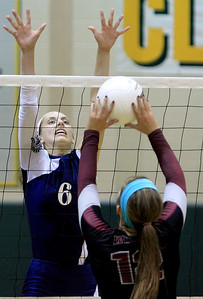Sarah Nader - snader@shawmedia.com Cary-Grove's Amy Jereb (left) jumps to block a shot by Prairie Ridge's Mackenzie Humm  during Tuesday's Class 4A Crystal Lake South Regional volleyball tournament against Prairie Ridge on October 20, 2012 in Crystal Lake. Prairie Ridge won, 2-1