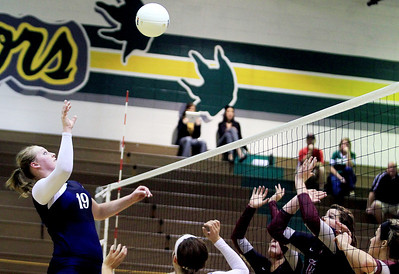 Sarah Nader - snader@shawmedia.com Cary-Grove's Mallory Wilczynski (left) spikes the ball over the net  during Tuesday's Class 4A Crystal Lake South Regional volleyball tournament against Prairie Ridge on October 20, 2012 in Crystal Lake. Prairie Ridge won, 2-1