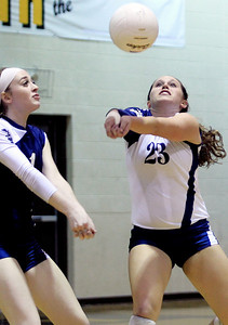 Sarah Nader - snader@shawmedia.com Cary-Grove's Micah Duzey (right) returns the ball during Tuesday's Class 4A Crystal Lake South Regional volleyball tournament against Prairie Ridge on October 20, 2012 in Crystal Lake. Prairie Ridge won, 2-1.