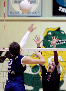 Sarah Nader - snader@shawmedia.com Prairie Ridge's Taylor Otto (right) jumps to block a shot by Cary-Grove's Alex Larsen (right) during Tuesday's Class 4A Crystal Lake South Regional volleyball tournament on October 20, 2012 in Crystal Lake. Prairie Ridge won, 2-1.