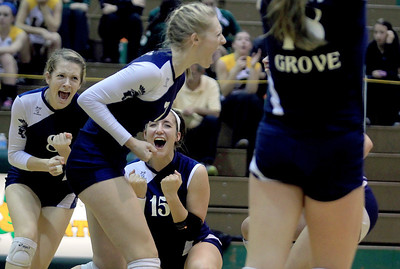 Sarah Nader - snader@shawmedia.com Cary-Grove celebrates a point during Tuesday's Class 4A Crystal Lake South Regional volleyball tournament against Prairie Ridge on October 20, 2012 in Crystal Lake. Prairie Ridge won, 2-1.