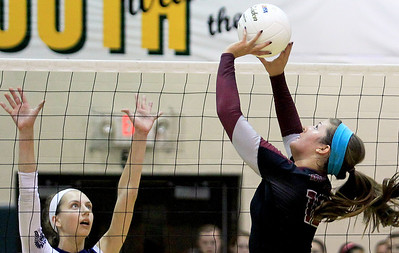 Sarah Nader - snader@shawmedia.com Cary-Grove's Amy Jereb (left) jumps to block a shot hit by Prairie Ridge's Mackenzie Humm  during Tuesday's Class 4A Crystal Lake South Regional volleyball tournament on October 20, 2012 in Crystal Lake. Prairie Ridge won, 2-1.