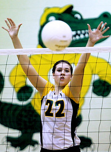 Sarah Nader - snader@shawmedia.com Crystal Lake South's Kylie Portera jumps to block the ball Tuesday's Class 4A Crystal Lake South Regional volleyball tournament against Jacobs on October 20, 2012 in Crystal Lake.