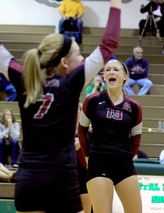 Sarah Nader - snader@shawmedia.com Prairie Ridge's Ali Witt (right) celebrates a point during Thursday's Crystal Lake South in the Class 4A Crystal Lake South Regional volleyball tournament final against Crystal Lake South in Crystal Lake on Thursday, October 25, 2012. Prairie Ridge won, 2-1.