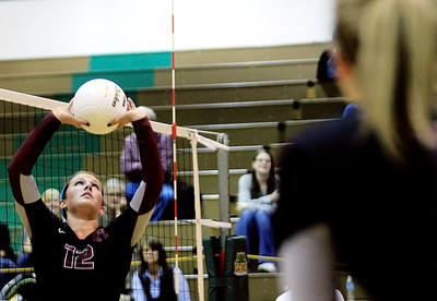 Sarah Nader - snader@shawmedia.com Prairie Ridge's Mackenzie Humm sets the ball during Thursday's Class 4A Crystal Lake South Regional volleyball tournament final against Crystal Lake South in Crystal Lake on October 25, 2012. Prairie Ridge won, 2-1.