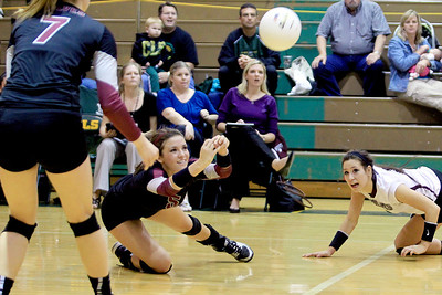 Sarah Nader - snader@shawmedia.com Prairie Ridge's Nikki Kirchberg (left) dives for the ball during Thursday's Class 4A Crystal Lake South Regional volleyball tournament final against Crystal Lake South in Crystal Lake on Thursday, October 25, 2012. Prairie Ridge won, 2-1.