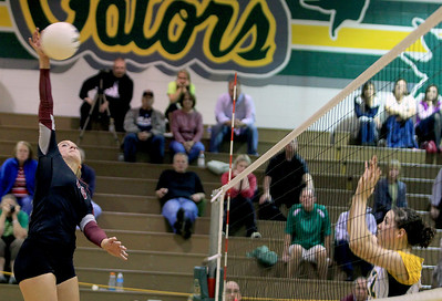 Sarah Nader - snader@shawmedia.com Prairie Ridge's Ali Witt (left) taps the ball over during Thursday's Crystal Lake South in the Class 4A Crystal Lake South Regional volleyball tournament final against Crystal Lake South in Crystal Lake on Thursday, October 25, 2012. Prairie Ridge won, 2-1.