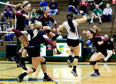 Sarah Nader - snader@shawmedia.com The Prairie Ridge volleyball team celebrates after beating Crystal Lake South in the Class 4A Crystal Lake South Regional volleyball tournament final in Crystal Lake on Thursday, October 25, 2012. Prairie Ridge won, 2-1.