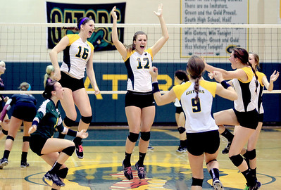 Sarah Nader - snader@shawmedia.com The Crystal Lake South volleyball team celebrates a game two win during Thursday's Class 4A Crystal Lake South Regional volleyball tournament final against Prairie Ridge in Crystal Lake on Thursday, October 25, 2012. Prairie Ridge won, 2-1.