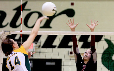 Sarah Nader - snader@shawmedia.com Prairie Ridge's Taylor Otto (right) jumps to block a shot by Crystal Lake South's Avalon Nero during Thursday's Class 4A Crystal Lake South Regional volleyball tournament final in Crystal Lake on October 25, 2012. Prairie Ridge won, 2-1.