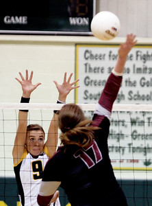 Sarah Nader - snader@shawmedia.com Crystal Lake South's Nicole Jurkash (left) jumps to block a shot hit by Prairie Ridge's Maddie Drain during Thursday's Class 4A Crystal Lake South Regional volleyball tournament final against in Crystal Lake on October 25, 2012. Prairie Ridge won, 2-1.