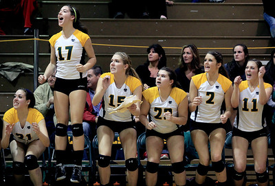Sarah Nader - snader@shawmedia.com The Crystal Lake South volleyball team celebrates a point during Thursday's Class 4A Crystal Lake South Regional volleyball tournament final against Prairie Ridge in Crystal Lake on Thursday, October 25, 2012. Prairie Ridge won, 2-1.