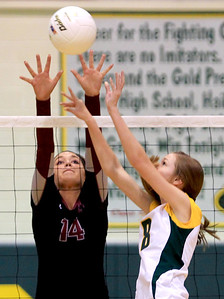 Sarah Nader - snader@shawmedia.com Prairie Ridge's Kennedy McNeil (left) jumps to block a shot by Crystal Lake South's Cassy Sivesind during Thursday's Class 4A Crystal Lake South Regional volleyball tournament final in Crystal Lake on October 25, 2012. Prairie Ridge won, 2-1.