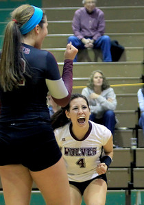 Sarah Nader - snader@shawmedia.com Prairie Ridge's Paige Dacanay (right) celebrates a point during Thursday's  Class 4A Crystal Lake South Regional volleyball tournament final against Crystal Lake South in Crystal Lake on Thursday, October 25, 2012. Prairie Ridge won, 2-1.