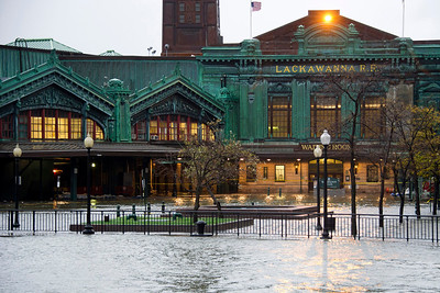 The Hudson River swells and rises over its banks flooding the Lackawanna train station as Hurricane Sandy approaches, in Hoboken, NJ on Monday, Oct. 29, 2012. Hurricane Sandy continued on its path Monday, as the storm forced the shutdown of mass transit, schools and financial markets, sending coastal residents fleeing, and threatening a dangerous mix of high winds and soaking rain.  (AP Photo/Charles Sykes)