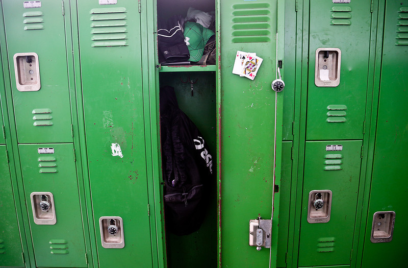 Josh Peckler - Jpeckler@shawmedia.com  A locker is left open with three playing cards posted inside by one of the players on Alden-Hebron's football team before they played Marquette Academy at Alden-Hebron High School Saturday, September 29, 2012.