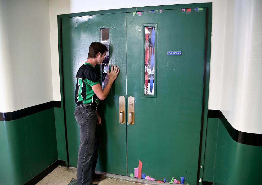 Josh Peckler - Jpeckler@shawmedia.com Alden-Hebron's Jaritt Cornett looks inside the gym before Alden-Hebron played Marquette Academy at Alden-Hebron High School Saturday, September 29, 2012.