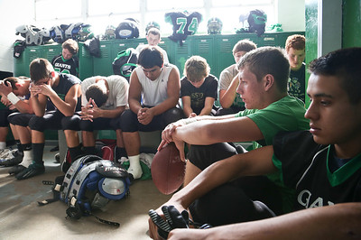 """Josh Peckler - Jpeckler@shawmedia.com Members of the Alden-Hebron football team listens to a inspirational  speech given by Al Pacino in the movie """"Any Given Sunday"""" on a CD player before playing Marquette Academy inside the locker room at Alden-Hebron High School Saturday, September 29, 2012."""