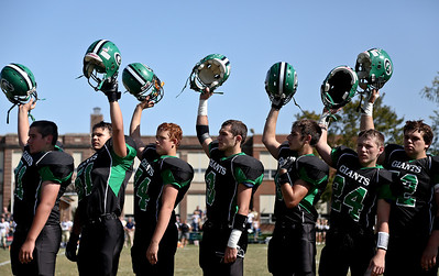 Josh Peckler - Jpeckler@shawmedia.com Members of the Alden-Hebron football team raise their helmets during the National Anthem before Alden-Hebron played Marquette Academy at Alden-Hebron High School Saturday, September 29, 2012.
