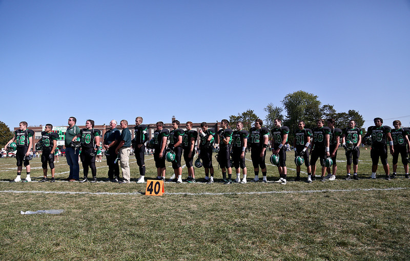 Josh Peckler - Jpeckler@shawmedia.com The 18 members of the Alden-Hebron High School football team and coaches line up for the Star Spangled Banner before playing Marquette Academy at Alden-Hebron High School Saturday, September 29, 2012.
