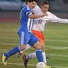 St. Charles East's Brad Corirossi and Larkin's Erik Rodriguez battle for control of the ball during the York sectional championship game Friday Oct. 26 in Elmhurst.<br /> Staff photo by Mark Busch