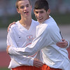 St. Charles East's T.C. Hull, left is congratulated by Taylor Ortiz after scoring a goal during the York sectional championship game against Larkin Friday Oct. 26 in Elmhurst.<br /> Staff photo by Mark Busch