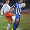 St. Charles East's Brad Corirossi tries to steal the ball from Larkin's Erik Rodriguez during the York sectional championship game Friday Oct. 26 in Elmhurst.<br /> Staff photo by Mark Busch