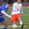 St. Charles East's Justin Stanko kicks the ball upfield during the York sectional championship game against Larkin Friday Oct. 26 in Elmhurst.<br /> Staff photo by Mark Busch