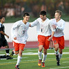 St. Charles East's Taylor Ortiz (8) and Eric Dietrich (11) congratulate teammate Kevin Kurtz (19) on his goal during their 4-0 3A York Sectional semifinal win over Streamwood in Elmhurst Tuesday afternoon.