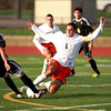 St. Charles East's Michael Macek (6) goes after the ball during their 4-0 3A York Sectional semifinal win over Streamwood in Elmhurst Tuesday afternoon.