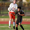 St. Charles East's Brian Gielow (9) tries to control the ball during their 4-0 3A York Sectional semifinal win over Streamwood in Elmhurst Tuesday afternoon.