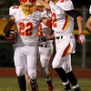 Anthony Thielk (22) of Batavia is congratulated by teammate Zachary Strittmatter (82) after Thielk's touchdown in the first half of their game at St. Charles East Friday night. (Sandy Bressner photo)