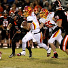 Batavia quarterback Micah Coffey keeps the ball during their game at St. Charles East Friday night. (Sandy Bressner photo)