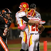 Batavia's Anthony Scaccia (28) congratulates teammate Zachary Strittmatter (82) on his touchdown in the first half of their game at St. Charles East Friday night. (Sandy Bressner photo)
